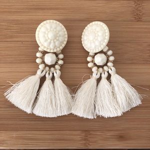 White tassle earrings